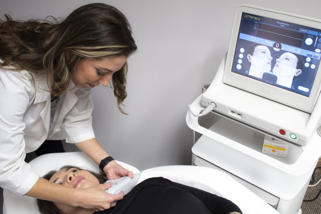 Specialist at Docere giving a facial to a client at Docere Medspa.